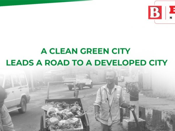 A clean green city leads a road to a developed city